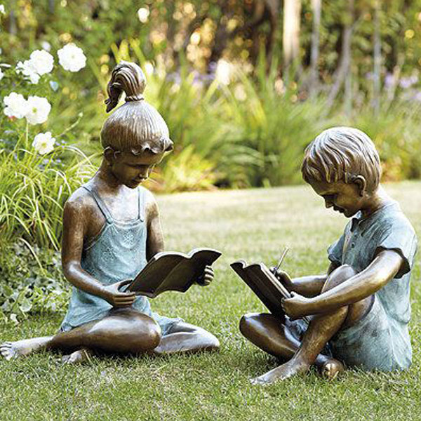 Garden ornaments bronze casting girl and boy reading books statues outdoor