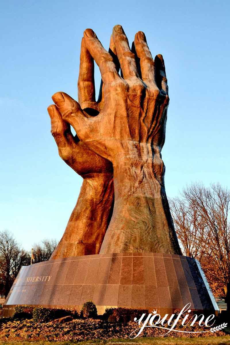 black praying hands statue