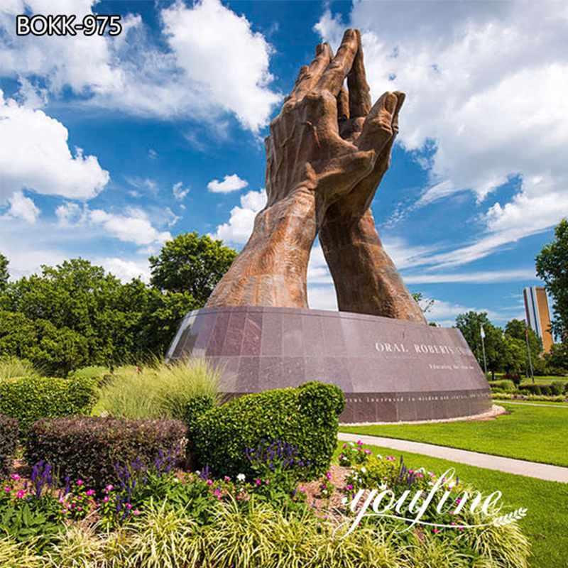 large praying hands statue